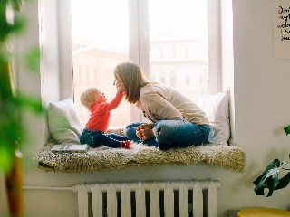 pexels-stock-photo-adorable-baby-babysitter-1257110